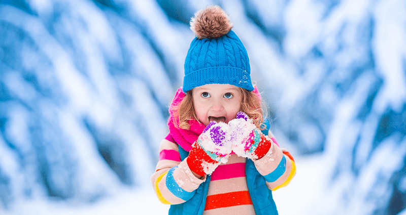 A girl playing with snow.
