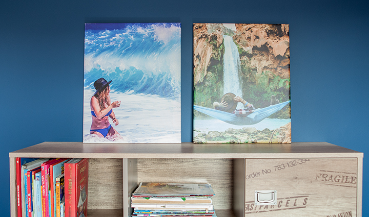 2 travel photo canvases on a shelf