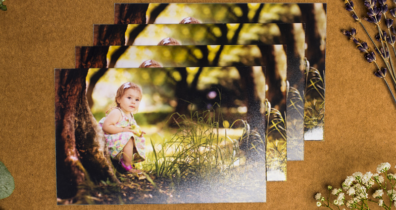 4 photos of a small girl by a tree – photos printed on 4 paper types.