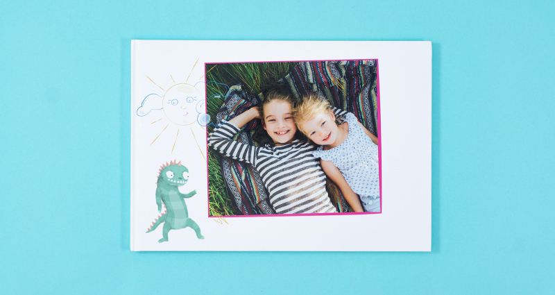 A Photo Book with a picture of a child on the cover and some clip art