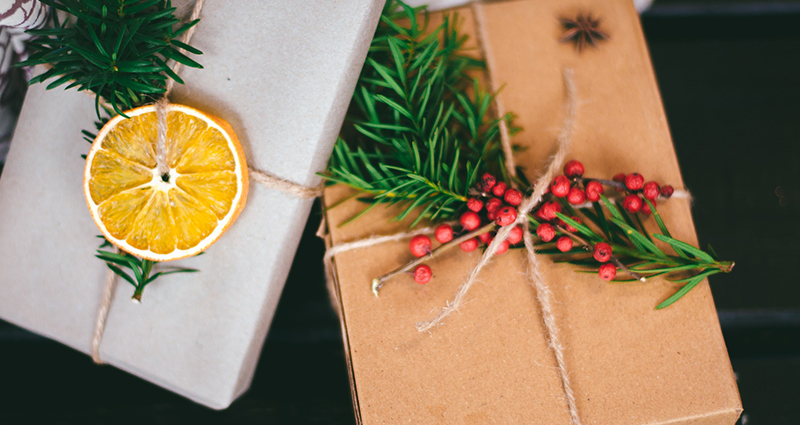 A gift decorated with lemon and mountain ash.