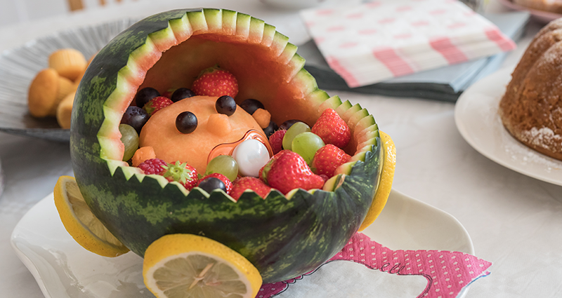 A watermelon carved to look like a cradle