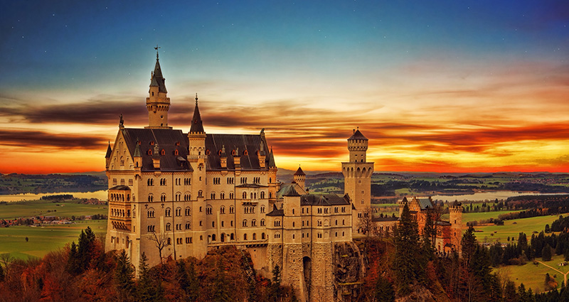 Castle in Neuschwanstein at sunset. Seen from afar.