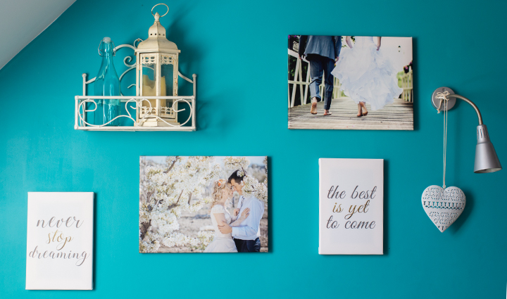 Collection of canvases on a wall – 2 canvases with pictures and 2 with sayings