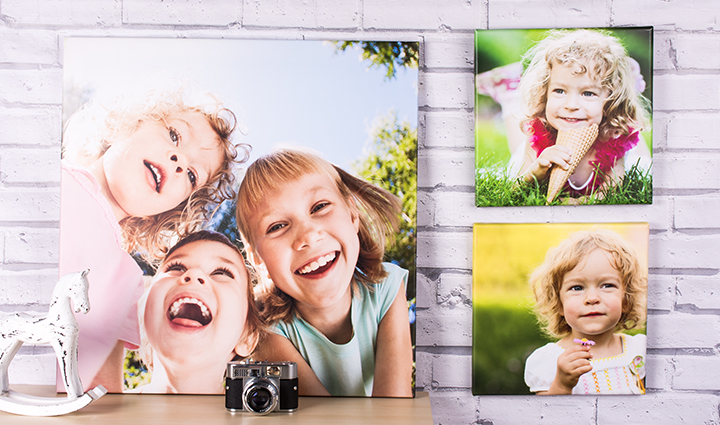 Collection of children canvases on a masonry wall