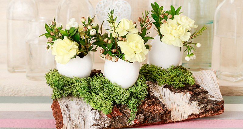 Easter table piece made from a birch log and blown eggs.