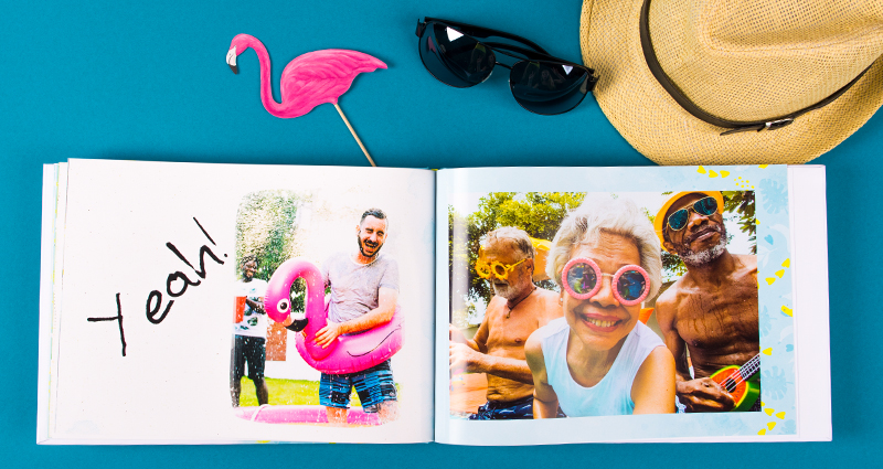 Family holiday photobook with a clipart, a straw hat, sunglasses and a pink flamingo above.