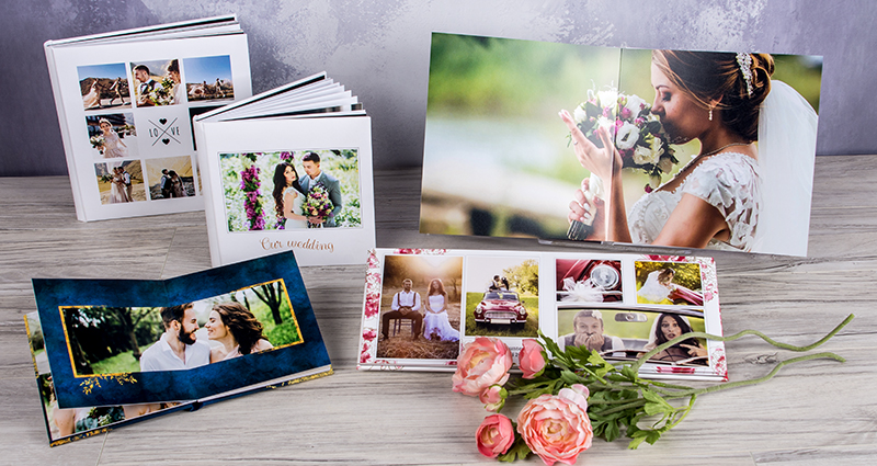 Five wedding layflat albums in various sizes, 3 of them are open flat