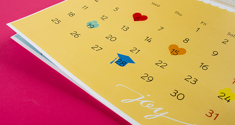 Focus on the calendar's timeline with marked holidays; pink background