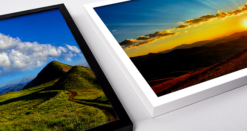 Focus on two framed landscape canvases