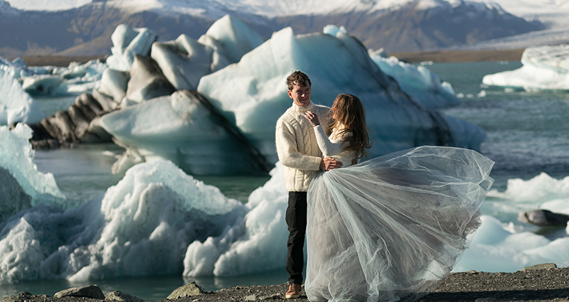 A photo of newlyweds in Iceland. Glaciers in the background.