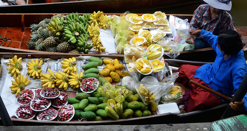 Local people offering fruits on the boat