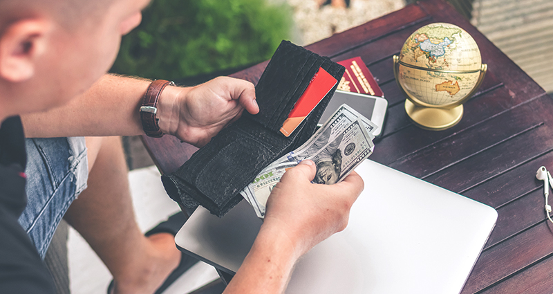 Man pulling money from a wallet
