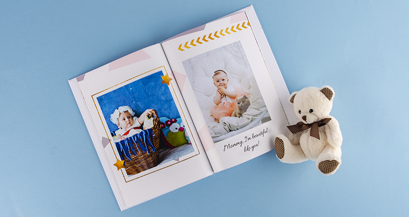 Photo book of a newborn baby's picture next to a teddy bear - 2