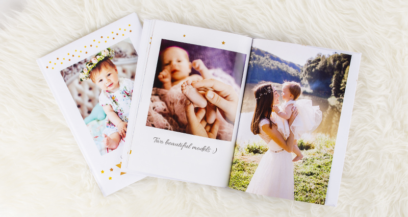 Photo books with pictures of mum and her little daughter