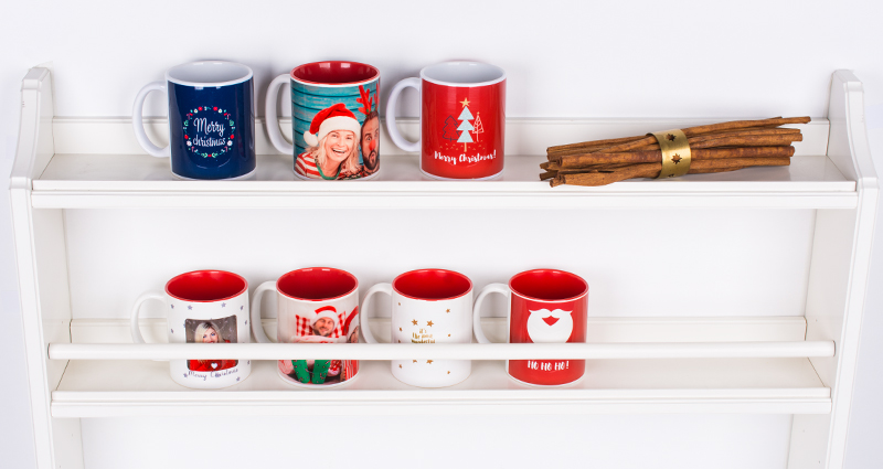 Photo mugs on a shelf.