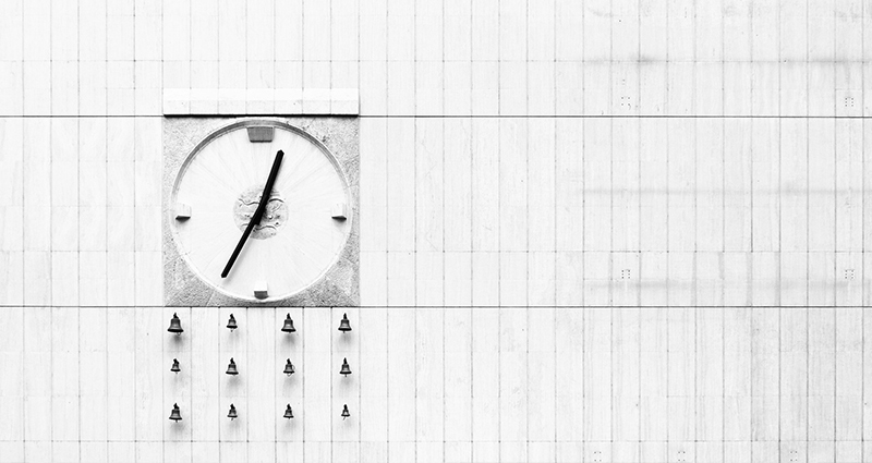 Picture of a clock on the white wall
