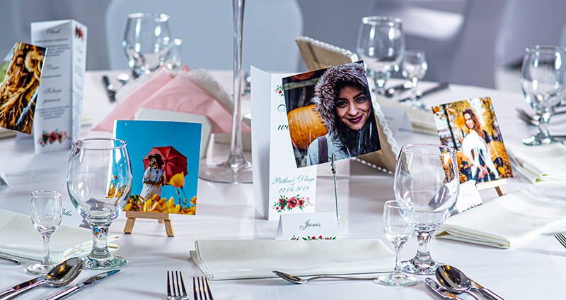 Place cards in the form of Insta Photos with the guests' photos placed in little plastic holders with a clip or wooden mini-easels on the wedding table