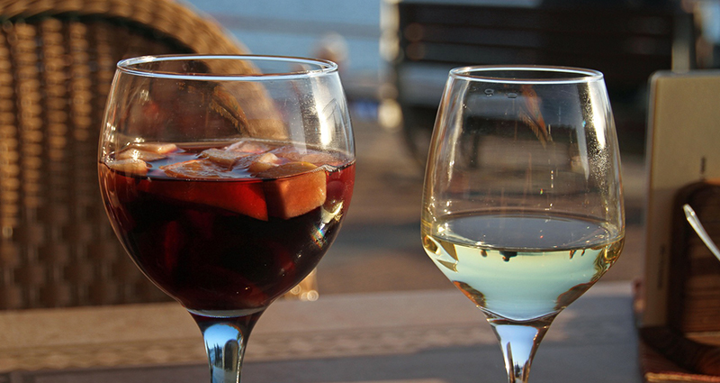 Spanish cuisine – one glass of sangria, one of white wine, photos taken in a patio