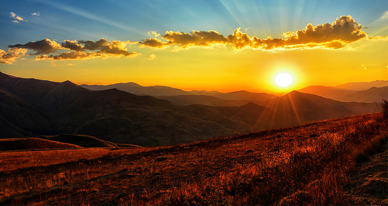 Sunset in the mountains, a picture in blue, orange and yellow colours