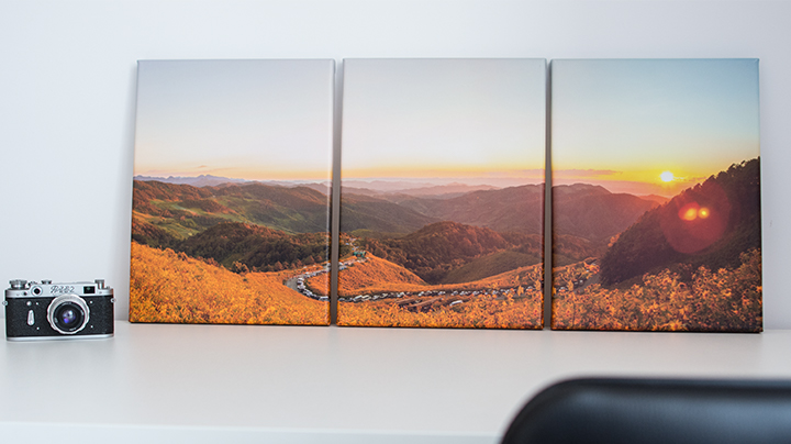 Triptych photo canvas on a desk