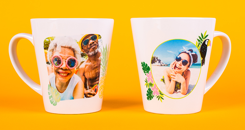 Two latte mugs with holiday photos on the orange background