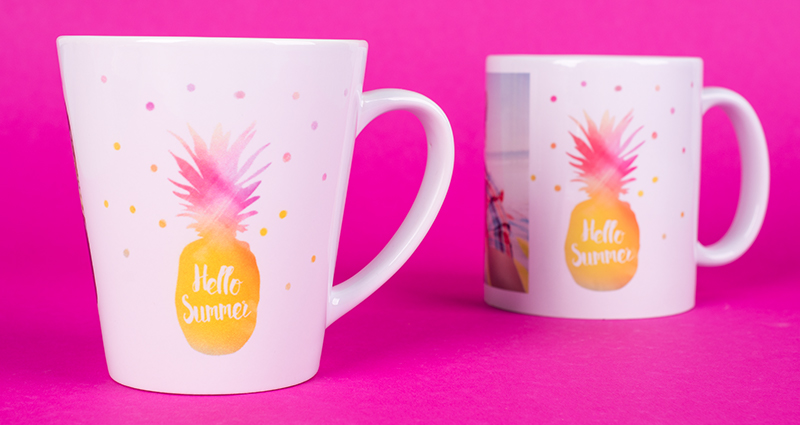 Two latte mugs with summer cliparts on the pink background