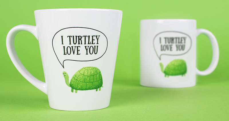 Two photo mugs – one coloured mug, one latte mug with a premade template on the green background
