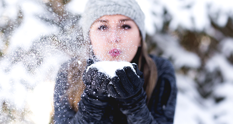 Woman blowing snow 2