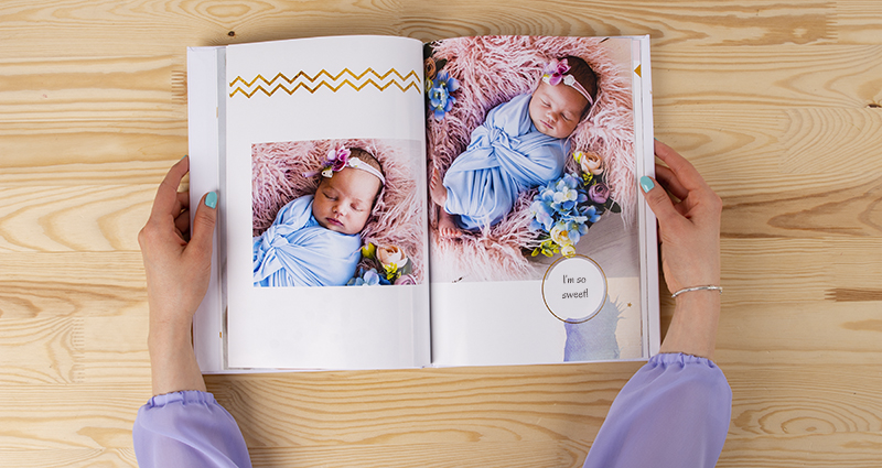 Woman holding a photo book from a newborn baby's photo shoot - 2