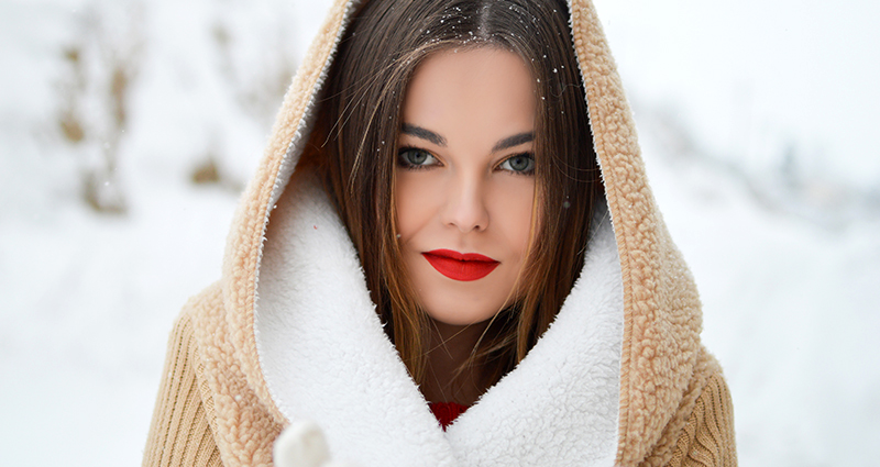 Woman in a hood with red lips