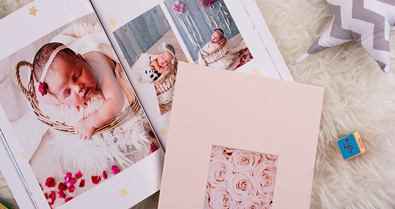 A pastel cover of our Photo Book Exclusive (newborn photo shoot)