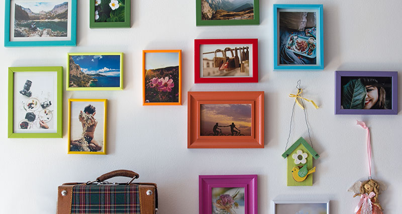 Photos in colourful frames hung on the wall.