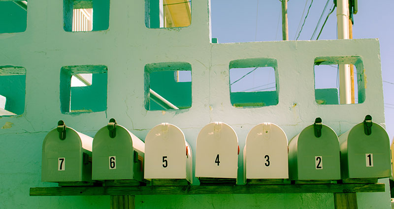 A row of green mailboxes.