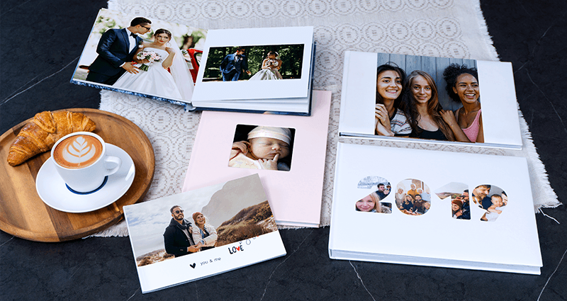 A Classic Photo Book, an Exclusive Photo Book, a Photo Album, a Starbook and an A5 Photo Book created using the Yearbook template