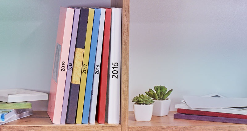 A Yearbook in the form of a Photo Book placed on a shelf