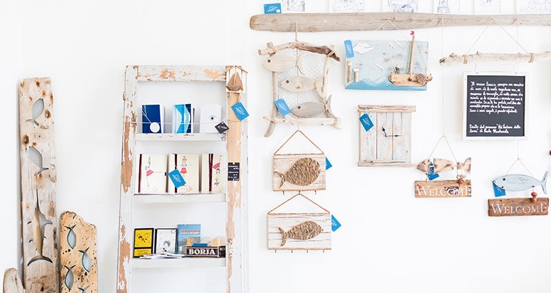 DIY wall with wooden shelves and decorations.